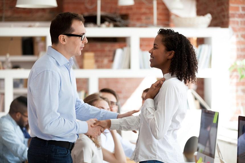 Man greeting an African woman