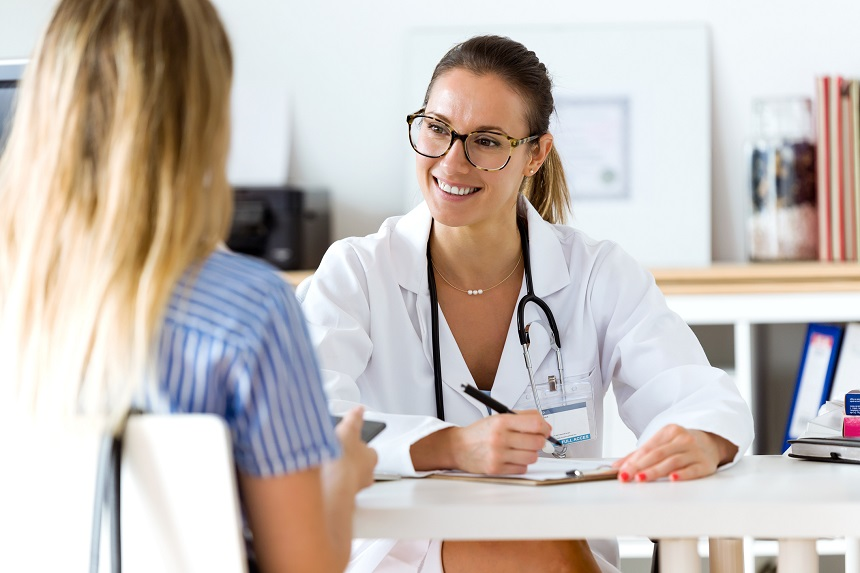 Female doctor explaining diagnosis to a woman