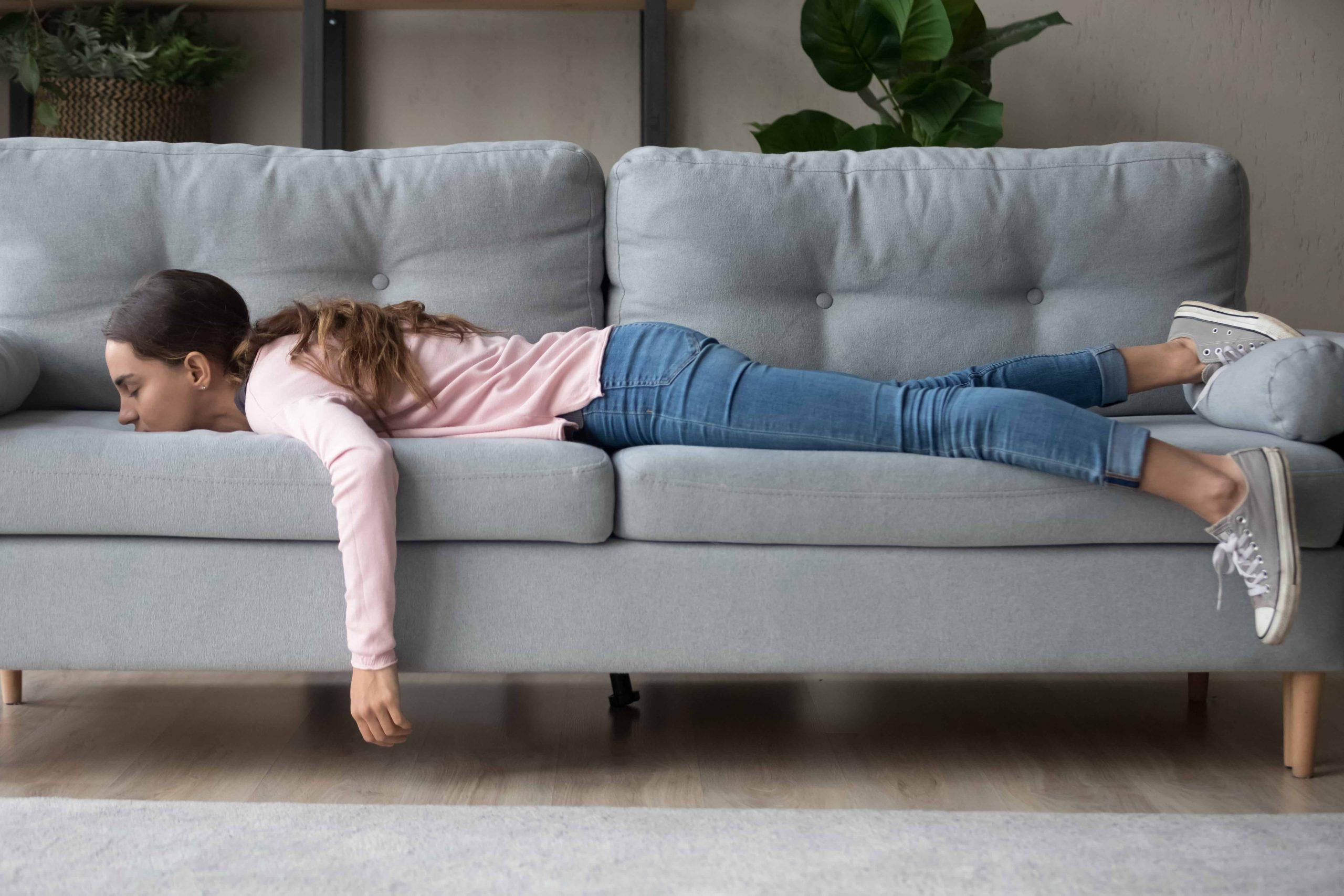 Tired girl lying on a sofa