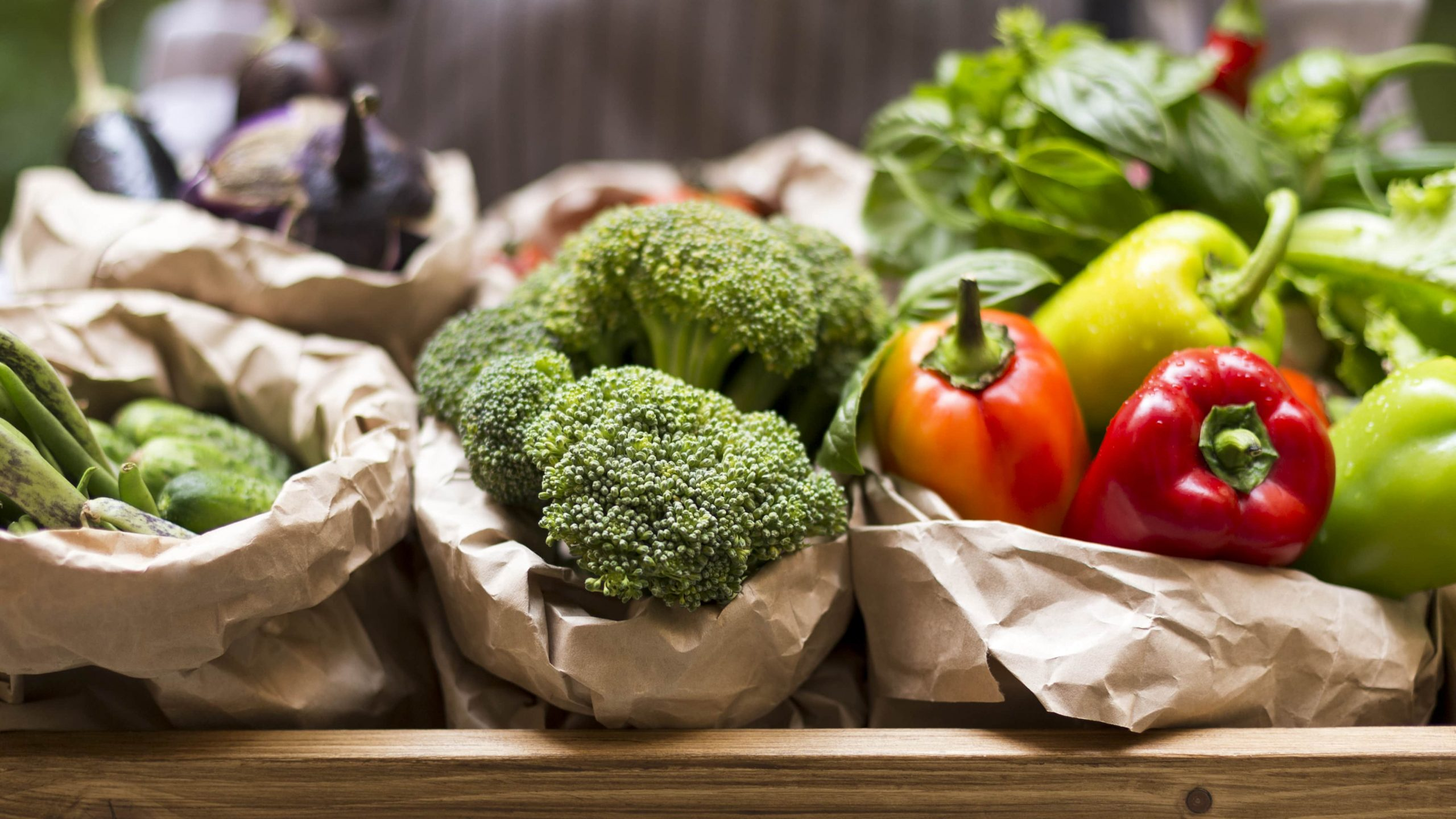 Green cauliflower and red and yellow paprika wrapped in paper