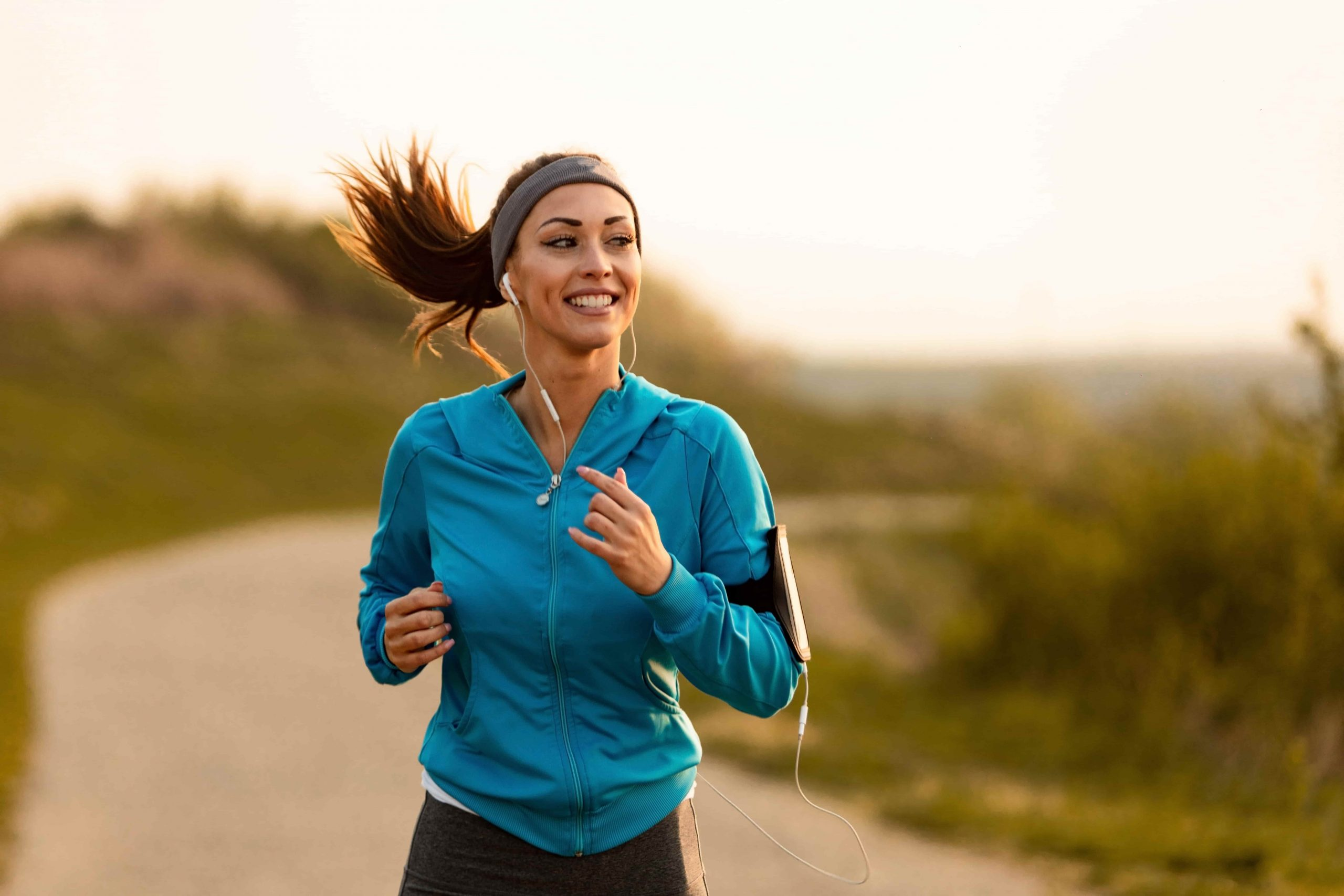 Woman jogging and listening to music in headphones