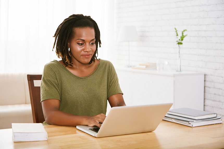 African woman working with her laptop Business woman working from home