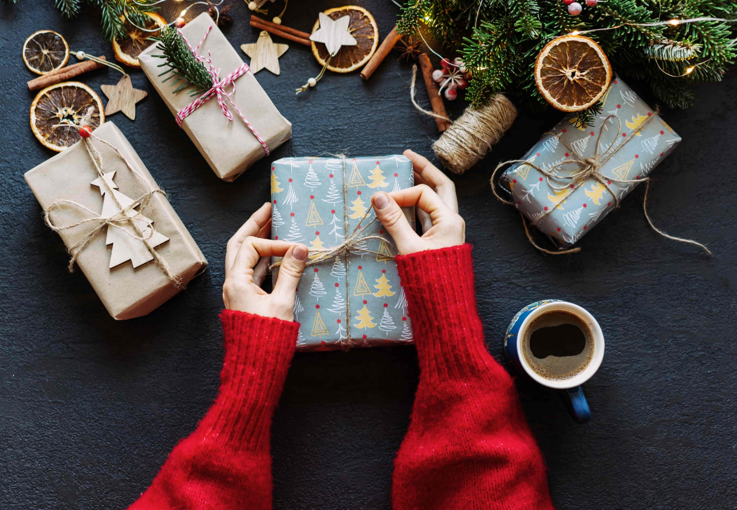Female hands wrapping presents