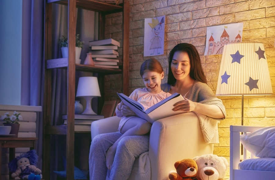 Boy and his mom reading a book in the evening insurance_coverage_during_covid_19_outbreak